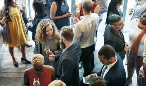 Business networking event. Groups of people in conversation.