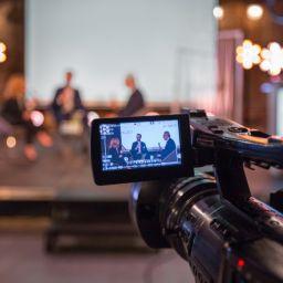 Closeup shot on camera of a live event.